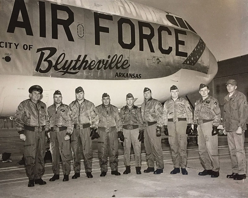 Photo of military personnel in front of Blytheville Air Force sign.